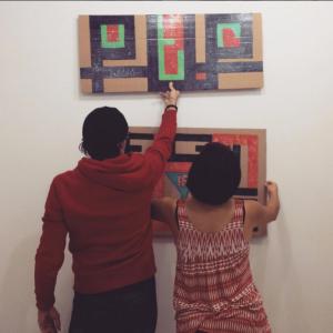 HAYP Pop Up Gallery curator Anna K Gargarian & artist Samvel Saghatelian installing the artworks
