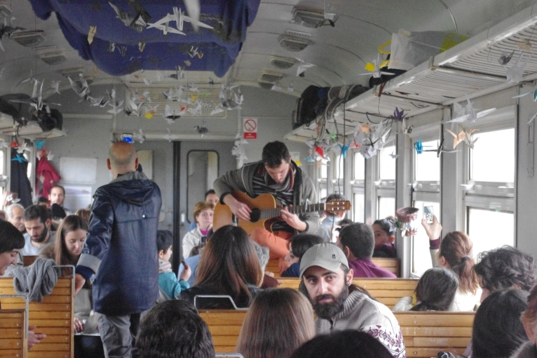 Ashod Papasian playing the guitar on the inaugural train ride. Photo credit: Setrag Shahikian